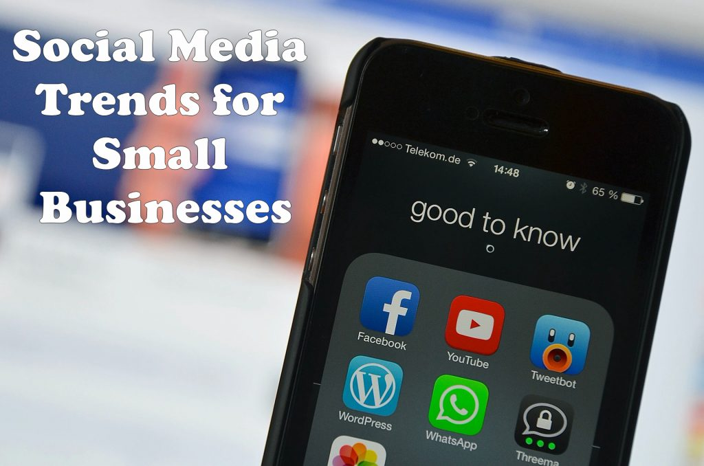 Social Media Trends for Small Businesses headline shown next to cell phone